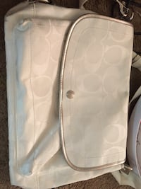 monogrammed white and gray Coach crossbody bag
