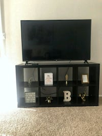black wooden TV stand with flat screen TV Houston, 77049
