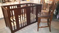 The Hi- seat chair to watch over baby in the crib