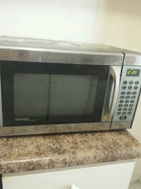 gray and black microwave oven 543 km