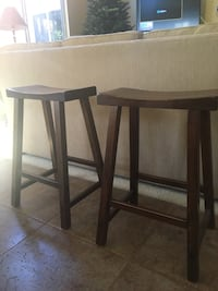 Counter high brown wooden stools (2)