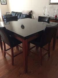 rectangular brown wooden table with four chairs dining set Hagerstown, 21740