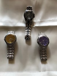 Three round silver-colored analog watches with link bands SWISS PARTS. Park Ridge