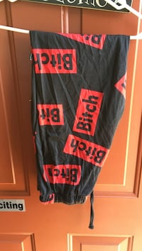 Black and red bitch print pants