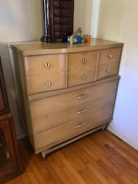 Blonde silver cone-leg wooden highboy dresser