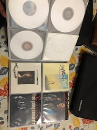 148 music cd's (1980's) with caselogic cases Surrey, V3W 5N6