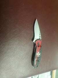 black and red handled stainless steel bi-fold pocket knife Lansing, 48910