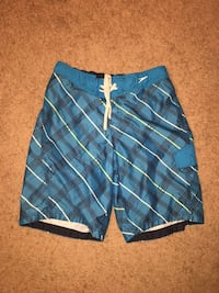 blue, white, and black plaid drawstring board shorts