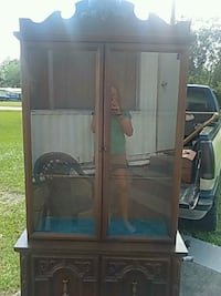 brown wooden framed glass display cabinet 692 mi