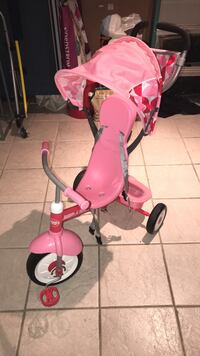 Baby's pink and red radio flyers trike
