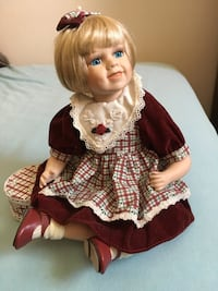 COLLECTABLE DOLL... 9 1/2 inch doll. Beautiful dimpled cherub porcelain face. Dollars in sitting position with a little toy inside the included box. In impeccable condition. Showpiece New York, 11229