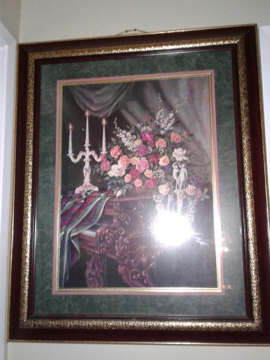 brown wooden framed pink flowers on upright piano painting