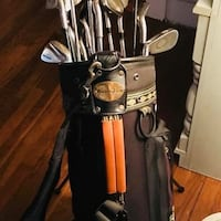 Vintage golf bag with a mixture of different clubs Mount Pleasant, 38474