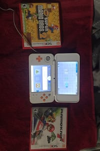 Nintendo 3DS with charger and two games