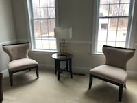 Two brown  wooden framed cream padded chairs Upper Marlboro, 20772