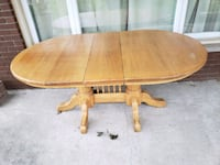 oval brown wooden pedestal table 663 km