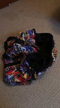 black and multicolored printed duffle bag