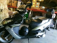 black and gray motor scooter 13 km