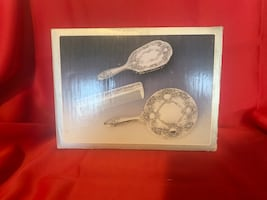 Antique silver plated brush, comb, and hand held mirror set