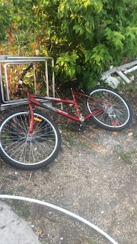 red and black full-suspension mountain bike Winnipeg, R2W 2S6