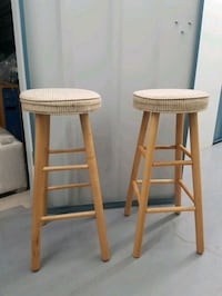 two brown wooden bar stools Toronto