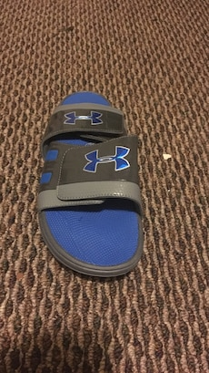 pair of black-blue-and-grey Unded Armour slide sandals