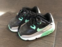 pair of black-and-green Nike running shoes Toronto, M3M 1E7
