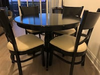 Round dining table with four chairs  Toronto, M8V