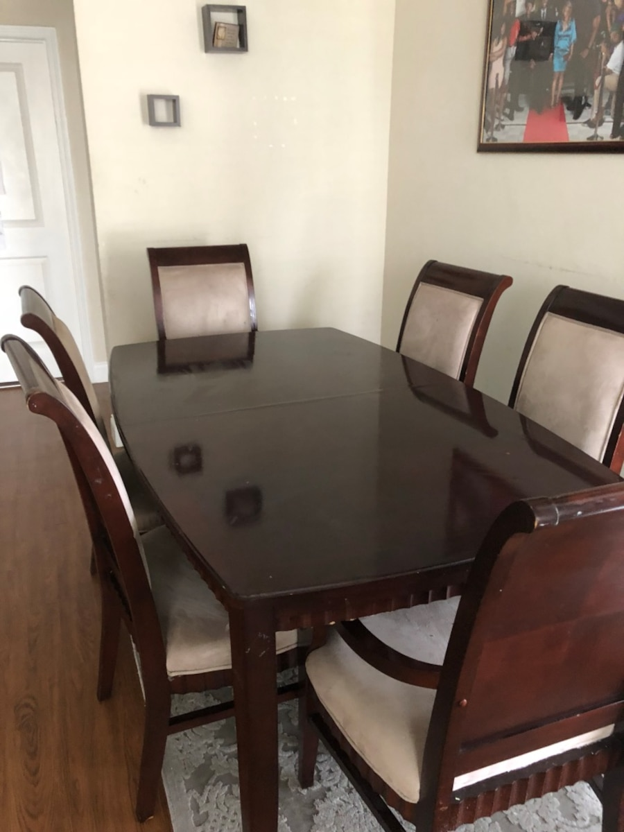 Used Wood Dining Table with 6 Chairs and Leaf in Orlando