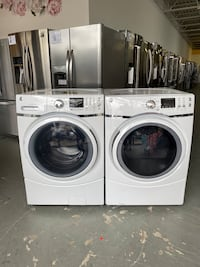 NEW GE front loading washer and electric dryer set!