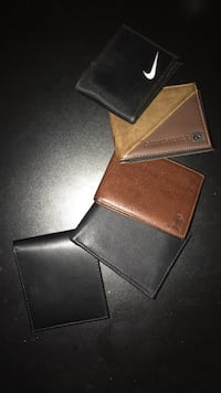 Five leather bifold wallets