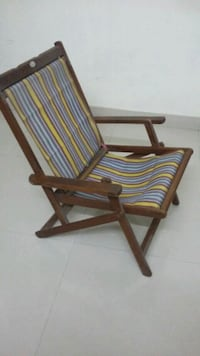 brown wooden framed blue and white stripe padded chair