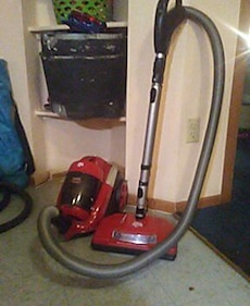 red and grey canister vacuum cleaner