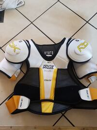 white, black, and yellow Reebok shoulder pads