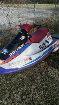white,red, and purple Polaris personal watercraft