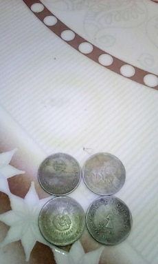 four round silver coins