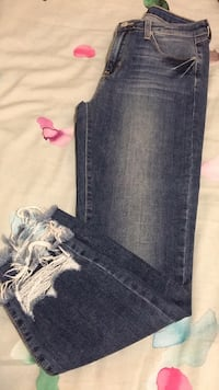 Blue denim straight cut jeans. Never worn. Size 27. Made in usa. Bought from M Boutique Toronto, M3A 1Y2