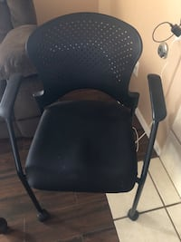 Black office chair with arm rests and wheels El Paso, 79938