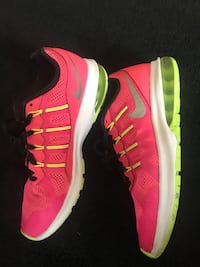 Pair of red nike running shoes Portland, 97225