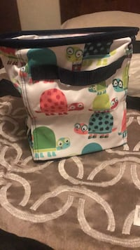 white, green, and pink Coach leather tote bag