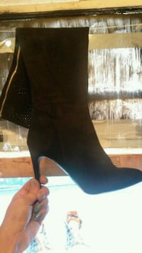 black pointed-toe high-heeled boots