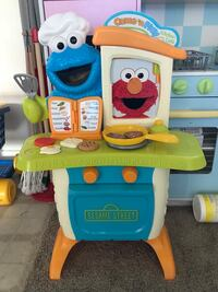 toddler's white and blue learning table