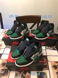 pair of black and green Nike basketball shoes 多伦多, M1S 2B8