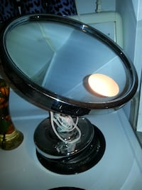 Magnified mirror with light