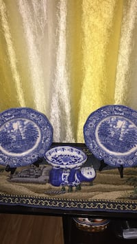 two blue-and-white toile decorative plates