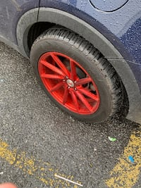 Red multi-spoke car wheel with tire New York, 11237