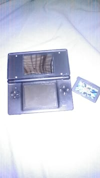 black Nintendo DS with game cartridge Calexico