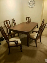 brown wooden dining table set 25 km