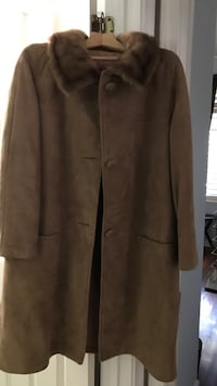 This suede coat is heavyweight with excellent lining for its age. There are zero tags I'd say it's a size 8 Roseville, 95661
