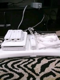 Wii with 4 controllers balance board and 2 games Coquitlam, V3K 5E8